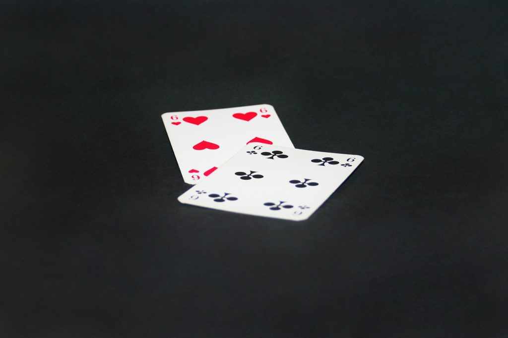 Online Baccarat - A close up of text on a black background - Crazy Eights
